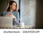 young business woman on the...   Shutterstock . vector #1064550149