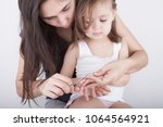 Mother Cutting Kids Nails