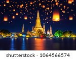 wat arun temple and floating... | Shutterstock . vector #1064566574