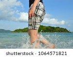 woman barefoot walking on the... | Shutterstock . vector #1064571821