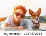 happy 9 year old boy hugging... | Shutterstock . vector #1064572955