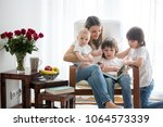 mother  playing with her... | Shutterstock . vector #1064573339