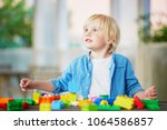 adorable little boy playing... | Shutterstock . vector #1064586857