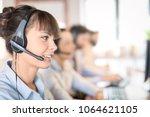call center worker accompanied... | Shutterstock . vector #1064621105
