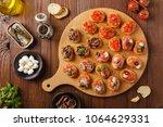 mix bruschetta with sardines... | Shutterstock . vector #1064629331