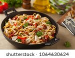 whole grain tagliatelle pasta... | Shutterstock . vector #1064630624