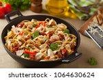 whole grain tagliatelle pasta... | Shutterstock . vector #1064630624