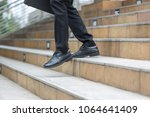 Small photo of bussiness person walk downstair in hurry movement