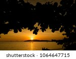 beautiful sunset on tropical... | Shutterstock . vector #1064647715
