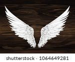 wings. vector illustration on... | Shutterstock .eps vector #1064649281