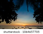beautiful sunset on tropical... | Shutterstock . vector #1064657705