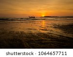 beautiful sunset on tropical... | Shutterstock . vector #1064657711
