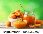 apricot jam in glass bowl with... | Shutterstock . vector #1064662559