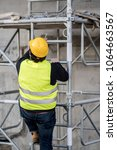 back turned construction worker ... | Shutterstock . vector #1064663567