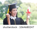 happy graduate young asian...   Shutterstock . vector #1064680247