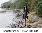 pretty girl in a plaid dress is ... | Shutterstock . vector #1064681135