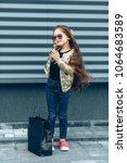trendy brunette girl in... | Shutterstock . vector #1064683589