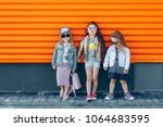 trendy girl team in sunglasses... | Shutterstock . vector #1064683595