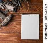 Small photo of Labor day background - many handy tools, on wooden background top view with copy space for text.