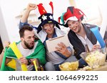 happy male friends cheering and ... | Shutterstock . vector #1064699225
