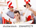 happy male friends cheering and ... | Shutterstock . vector #1064699279