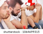 happy male friends cheering and ... | Shutterstock . vector #1064699315