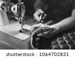 sewing process of the leather... | Shutterstock . vector #1064702831