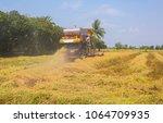 combine harvesters is working...   Shutterstock . vector #1064709935