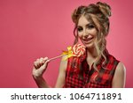 cheerful young woman stands... | Shutterstock . vector #1064711891