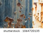 rusted blue and white painted... | Shutterstock . vector #1064720135