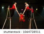 performance of aerialists in... | Shutterstock . vector #1064728511