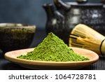 wooden pot with green matcha... | Shutterstock . vector #1064728781