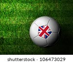 United Kingdom Flag Pattern 3d rendering of a soccer ball in green grass - stock photo