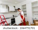 young repair man measuring... | Shutterstock . vector #1064751701