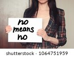 girl holds a paper sheet with... | Shutterstock . vector #1064751959