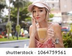young female model in street... | Shutterstock . vector #1064759561