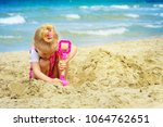 baby girl playing in the sand... | Shutterstock . vector #1064762651
