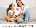 mother receiving a greeting... | Shutterstock . vector #1064762654