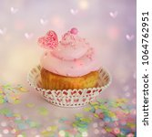 cupcake background with heart | Shutterstock . vector #1064762951