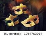 carnival mask background | Shutterstock . vector #1064763014