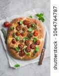 italian bread focaccia with... | Shutterstock . vector #1064764787
