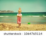 baby girl playing in the sand... | Shutterstock . vector #1064765114