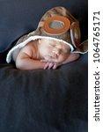 sweet little baby dreaming of... | Shutterstock . vector #1064765171