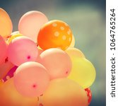 many colorful baloons in the... | Shutterstock . vector #1064765264