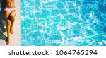 young woman in the swimming pool | Shutterstock . vector #1064765294