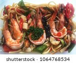 seafood pasta spaghetti with ... | Shutterstock . vector #1064768534