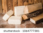 Small photo of Wood briquette and firewood, close-up