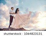 couple in love hugs kiss happy... | Shutterstock . vector #1064823131