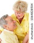 a handsome senior couple... | Shutterstock . vector #1064828504