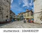Small photo of Split, Croatia - September 30 2017: Locals and tourists intermingle on a sunny morning in early autumn at the Fruit Square of Diocletian's Palace in the ancient city of Split, Croatia.